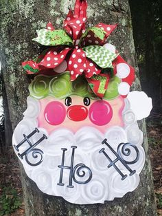 Ho..Ho..Ho Santa Door Hanger will look great on any door for the upcoming Christmas season. Made of wood and hand-painted by myself.    Please