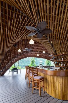 this bamboo structure was previously designed by bambubuild as an exhibition kiosk before finding new life as a bar and outdoor restaurant. Bamboo Architecture, Tropical Architecture, Sustainable Architecture, Architecture Design, Bamboo House Design, Tropical House Design, Tropical Houses, Bamboo Structure, Steel Structure