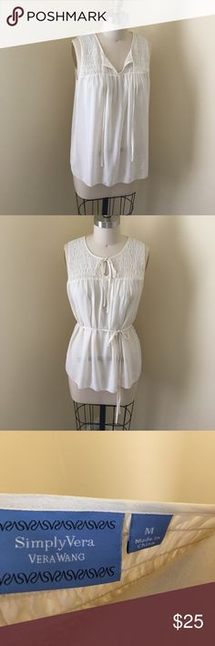Vera Wang Smocked Tank Ivory sheer Tank. Can be worn with optional belt. Sheer fabric would be best worn with nude Tank underneath. Color is ivory. Vera Wang Tops Tank Tops