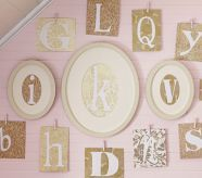 Love the different size/shape frames with letters. Cute for a nursery wall.