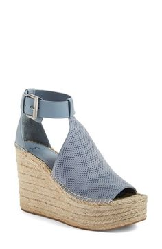 Free shipping and returns on Marc Fisher LTD Annie Perforated Espadrille Platform Wedge (Women) at Nordstrom.com. A perforated vamp connects an open toe and cutout ankle panels in this breezy platform wedge lifted by layers of artfully braided jute.