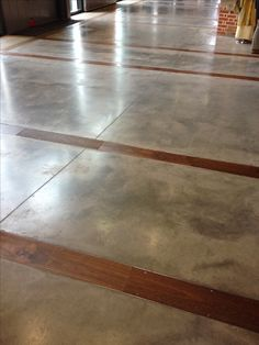 Concrete floors with wood inlay.