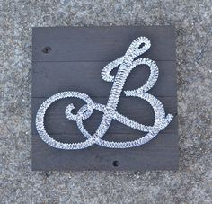 Initial String Art on 14x14 Stained Wood - This listing is for a customized initial string art piece. This is a great gift for any occasion!