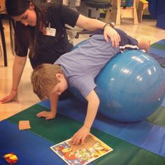 Heavy weight-bearing activity: prop hips and leg on peanut and hold torso weight on hands while doing a puzzle. Occupational Therapy Activities, Pediatric Occupational Therapy, Motor Skills Activities, Pediatric Ot, Gross Motor Skills, Sensory Activities, Activities For Kids, Cerebral Palsy Activities, Hand Therapy