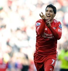 Luis Suarez celebrates after scoring Liverpool's opening goal against Stoke City at Anfield in the FA Cup Quarter-Final.