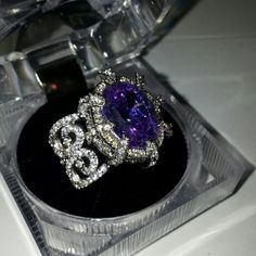 Additional Photos Ornate Stunningly Beautiful Ring This ring is a TRUE show stopper! The main stone is a lavender Oval Lab created Amethyst that measures an amazing 14x10. Beautiful scrolling detail enhances the amazing sparkling band. The prongs are dramatic & add yet another stunning focal point to the gorgeous main stone. This ring is a true ROCK STAR!!! 14K White gold over high quality jewelers brass. Lab created amethyst with a ton of gorgeous sparkly CZ's. Size 8 only. Plz see main…
