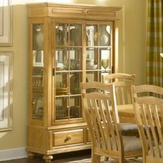 Bryson China Cabinet by Broyhill. $1063.05. Mirror back. Curio ends. 2 sliding doors. 3 adjustable glass shelves. Felt lined bottom drawers. 4933-560 Features: -Curio cabinet.-Casual traditional style.-Curio ends.-Mirror back.-Touch lights.-Wooden knobs.-Raised panel detailing.-Round bun feet. Includes: -Includes two drawers, two sliding doors and three adjustable glass shelves. Construction: -Pine solids and veneers construction. Color/Finish: -Warm pine stain finish. Collec...