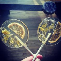 Lavender flavored lollipops with lemon slices and dried lavender flowers.