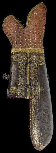 Indian dastana (vambrace / arm guard), 18th century, shaped to the fore-arm and decorated with broad borders of gold-damascened running foliage, hinged wrist-plate en suite, later velvet lining and velvet-lined leather hand-defense studded with brass nails, 48.5cm.