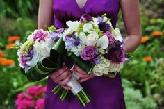Gorgeous bouquet made with a combination of White Hydrangea, Mini Green Hydrangea, Eggplant Callas, White Callas, Cool Water Roses, Mauve Freesia and Varigated Aspidestra Leaves. The colors are fresh and vibrant