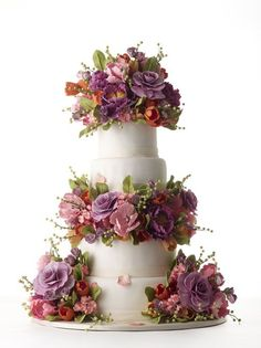 purple sugar flower covered cake