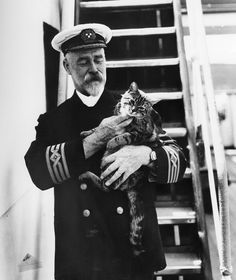 Captain A.J. Hailey and his cat 1920s
