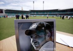 A photograph of Australian cricketer Phillip Hughes is displayed next to a condolences book.      Australia bid an emotional farewell to cricketer Phillip Hughes at a funeral in his hometown on Wednesday with a live coast-to-coast broadcast allowing a nation to unite in celebration of the life of a sportsman cut down in his prime. REUTERS/David Gray