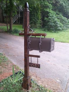 This is my mailbox my husband made out of all salvaged material he had in his basement, with the exception of the actual metal box that he bought for $15 on clearance at Home Depot.  He formed the numbers out of copper pipe and aged the post to match the old pallet wood he used in others parts.  All of the metal pieces were taken from an old metal chandelier I drug home.  It is the nicest mailbox in the neighborhood now. Craftsman Mailboxes, Farmhouse Mailboxes, Rustic Mailboxes, Cool Mailboxes, Mailbox Garden, Diy Mailbox, Mailbox Post, Mailbox Ideas, Lawn And Garden