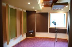 3:3:2 Studio by WSDG - vocal booth with acoustic absorption and diffusion.  Modular wall panels can help section room for multiple singers.