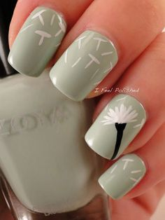 Use a matte olive polish as base color to stand out. The stem of the Dandelion is painted in black while the petals are in white colors perfectly contrasting the background.
