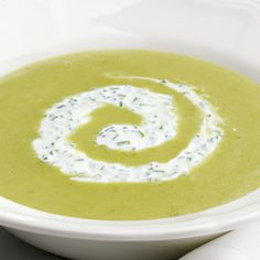Be sure to enjoy the first tender asparagus fresh from the garden or lightly blanched as a side dish, but as the season progresses and the stalks get larger, this is an excellent soup to prepare. The light, lemony flavors blend with a hint of curry; the soup is delicious served warm or chilled, topped with crème fraîche.