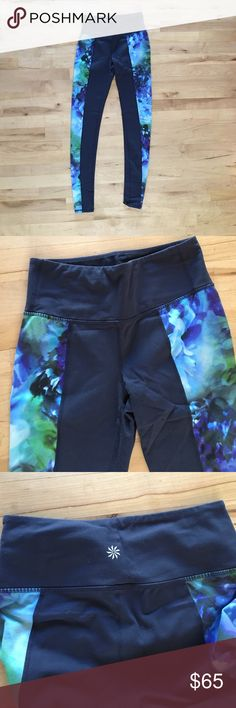 Athleta navy and floral leggings These are lovely! Minimal wear. They are mainly navy blue with floral pattern down the sides of the legs. Athleta Pants Leggings