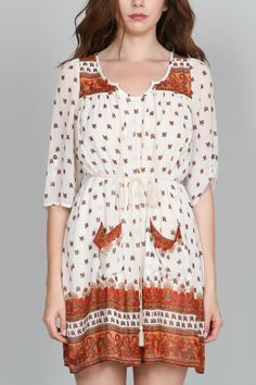 So cute with a pair of boots! Longhorn Fashions - White Printed Dress, $68.00 (http://www.longhornfashions.com/white-printed-dress/)