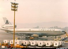 Mexicana Baggage and Cargo Containers with a McDonnell Douglas DC-10-15 in the Background