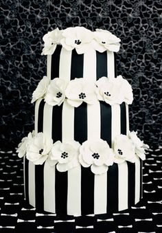 A chic monochrome design covered with black & white stripes Cascading Hydrangea petals, complemented by the subtle contrast of white & pastel pink create a soft and romantic look. The flowers are made of royal icing using a specialist piping technique. As shown, serves 200.