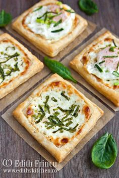 Minitartele: cut pastry dough into 6 squares. prick dough w/fork tine. Mix 1/2 c mozerella, 1/2 c feta, 4 T Greek yogurt, & some pepper. Spread on dough. Sprinkle on 4 chopped green onions & 4 slivered spinach leaves. Bake in 350 deg oven 15 mins. Remove f/oven. Can be served as is or top with a fried egg.