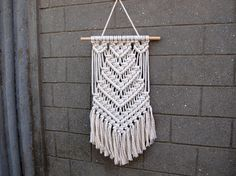 Color: off-white. Material: unbleached cotton rope, wood. Length of the wood is approx 34 cm (13 inches); macrame canvas is approx max 25 x 58 cm...