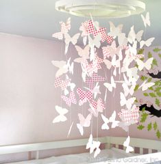 Make this paper butterfly mobile or chandelier for a nursery or a little girl's bedroom. You can use colourful wrapping paper or patterned s...