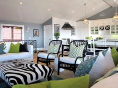 Amanda combined two black chairs from Ikea with higher-end textiles and a custom-made zebra ottoman. The cool blues and greens play well with the bold, contrasting black and white patterns.