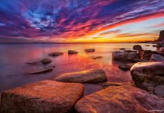 SUNRISE @ THE ROCKS...<br /> <br /> Here is a sunrise shot taken one morning at one of my favorite spots along the south shore of Lake Michigan. I had visited this spot a handful of times and the conditions had just never been quite right. This morning however, the stars aligned and I enjoyed this beautiful sunrise!!!!<br /> <br /> Awards:<br /> <br />  - Voted in the top 12 images of the day on Google+ by Photoextract.com: <a…