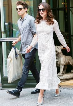Keira Knightley amps up a white lace dress with cool, metallic pumps. // #OutfitIdeas