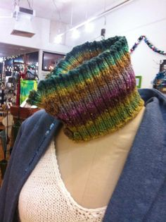 Noro neck warmer by Andrea Newell Greenfield! Oh so comfortable against the skin with a nature inspired colorway, this neckwarmer is made from 40% cotton, 30% silk, 15% wool and 15% nylon with buttons made from coconut. (Hand wash cold, lay flat to dry) Get this wonderful accessory today for only $39!