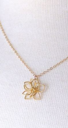 Idea to Make: Gold Delicate Flower Necklace- with gold colored copper wire bent into a flower shape :)