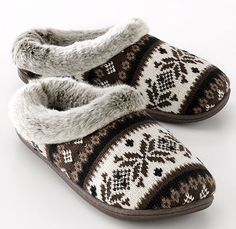 A pair of warm backless slippers, furry insides and rubber soles, I live in slippers! I wear size 9