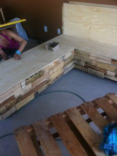 Building the lounge area for the front of the studio!  Smelling heavy of the forest.... #DIY #handmade #woodpallets #recycle #reuse #repurpose #wood #crafty   RaYoga.com  Come see it for yourself!