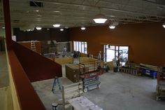 Check out our newly painted walls! On the far back wall, tile is going up in the coffee bar area!