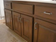 Re-glazed honey oak cabinets (using Benjamin Moore's Branchport Brown.) Holy cow, a lot of work, but... a pretty alternative to painting over cabinets