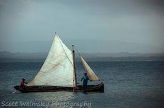 Local fishermen sail a small boat, Panama