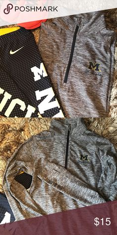 Michigan 1/4 zip Heathered Navy Michigan quarter zip. Lightweight, made of polyester and spandex. Thumb holes on sleeves with GO BLUE detail to left bottom sleeve. Colosseum Tops Sweatshirts & Hoodies