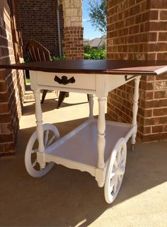 Drop leaf tea cart refinished with General Finishes Antique Walnut Gel Stain, and Annie Sloan Chalk Paint Pure White.
