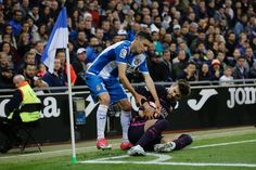 Barcelona's defender Gerard Pique (R) tries to keep the ball away from Espanol's defender Aaron during the Spanish league football match RCD Espanyol vs FC Barcelona at the Cornella-El Prat stadium in Cornella de Llobregat on April 29, 2017. / AFP PHOTO / PAU BARRENA