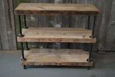 I think we can make a few of these for a little less. Industrial Reclaimed Wood shelves (3 shelves). $795.00, via Etsy.