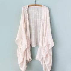One $10 scarf equals one killer new kimono! Try this easy DIY and prep your wardrobe for summer!