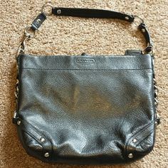 Coach leather purse Authentic black pebbled leather Coach purse. Used only once in mint condition. Inside zipper pocket with two open smaller pockets on opposite side. Metal detail shown in pictures on outside of purse. Beautiful purple satin interior. Dimensions 12x9x3. Price is firm. Coach Bags Shoulder Bags
