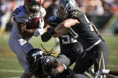Sean Lee Photos Photos - Team Rice running back Doug Martin #22 of the Tampa Bay Buccaneers is stopped by Team Irvin cornerback Richard Sherman #25 of the Seattle Seahawks and Sean Lee #50 of the Dallas Cowboys during the first half of the 2016 Pro Bowl at Aloha Stadium on January 31, 2016 in Honolulu, Hawaii. - AFC-NFC Pro Bowl