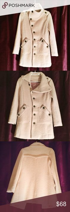 """Beautiful pinkish cream wool winter coat Stunning. Can be worn buttoned alll the way up (as in second picture) for a more military-style effect; or folded over a little for an asymmetrical look. One button is a little loose, but attached, and the lining is ripped on the inside, about 7"""". Neither are noticeable at all when its in, and are quick DIY fixes. Speaking of the loose button...I would recommend this coat for a B-C cup or smaller. It is tight across my chest, and I'm a 36 C/D. Such a…"""