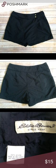 "EDDIE BAUER Activewear Shorts/Skirt Comfy, practical black Eddie Bauer outdoor wear - great for kayaking, canoeing, hiking.  They are shorts from the back with a panel going across the front so they look like a skirt at the front- so kind of shorts and yet kind of a skirt ☺️ // 15"" at waist laid flat and 14"" long Eddie Bauer Shorts Skorts"