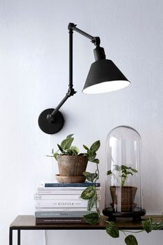 cordless black lamp attached to wall
