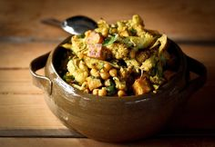 A flavorful recipe for Roasted Indian Cauliflower with Chickpeas and Tofu, a delicious vegan meal that comes together simply.