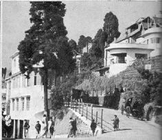 Below Keventer's, British ladies prancing up towards Planter's Club during the 1930s